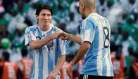 Juan Sebastián Verón y Lionel Messi en un entrenamiento de la selección argentina. Foto: Archivo El País