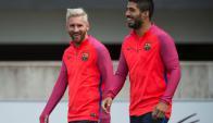 Lionel Messi y Luis Suárez en el entrenamiento de Barcelona. Foto: Reuters.