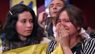 Centenares de colombianos rompieron en llanto al conocer el resultado. Foto: AFP