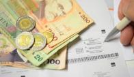El pago mínimo solo cubre una porción del capital adeudado, ya que parte del mismo son los intereses. Foto: Gerardo Pérez.