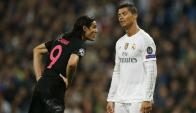 Edinson Cavani y Cristiano Ronaldo en el Real Madrid-PSG. Foto: Reuters