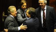 Los intendentes de Colonia y Cerro Largo ayer junto a los senadores Lacalle y Heber.