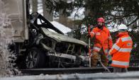Oficiales trabajan en el lugar del accidente. Foto: AFP