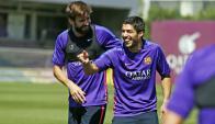 Luis Suárez y Gerard Piqué. Foto: Barcelona