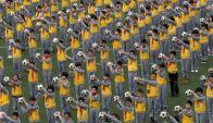 Niños chinos se ejercitan por la mañana. Foto: Reuters.