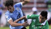 """Como en 2012. Álvaro """"Tata"""" González y Rudy Cardozo estarán frente a frente en La Paz. Foto: AFP"""