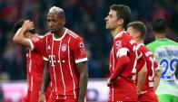 Jerome Boateng y Thomas Muller desolados tras el partido del Bayern. Foto: Reuters