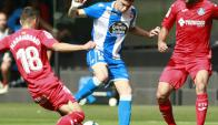 La marca de Mauro Arambarri a Federico Valverde en el Deportivo-Getafe. Foto: EFE