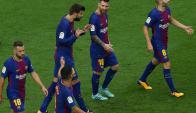 El diálogo entre Luis Suárez y Lionel Messi tras el gol. Foto: Reuters