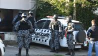 Las comparecencias judiciales fueron vigiladas por personal fuertemente armado. Foto: Ariel Colmegna