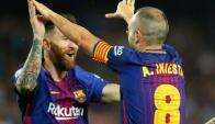 Lionel Messi y Andrés Iniesta. Foto: Reuters