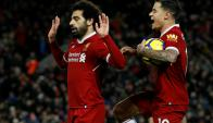 Mohamed Salah y Philippe Coutinho en el festejo de Liverpool. Foto: Reuters