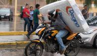 Tegucigalpa: saqueos y destrozos en la capital de Honduras. Foto: AFP