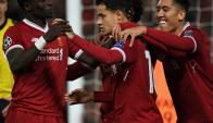 Los cuatro fantásticos de Liverpool: Mané, Firmino, Salah y Coutinho. Foto: AFP