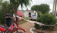 La casa donde ocurrió el tiroteo se encuentra con custodia policial. Foto: El País.