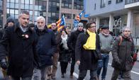 El expresidente catalán y requerido por la Justicia española en la marcha ayer en Bruselas. Foto: AFP