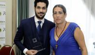 El galardonado Andrés Ojeda y Noelia Franco, responsable del evento.
