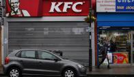 Kentucky Fried Chicken es una franquicia de restaurantes de comida rápida especializada en pollo frito con más de 18.000 restaurantes en 120 países. Foto: AFP