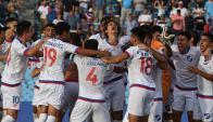Los jugadores de la cantera de Nacional festejan el triunfo en la Copa Libertadores sub 20. Foto: Ariel Colmegna