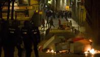 Disturbios: provocados por la muerte el jueves por la noche de un hombre de origen senegalés en el céntrico barrio madrileño de Lavapiés. Foto: AFP