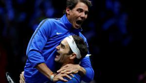 Rafael Nadal y Roger Federer en una celebración histórica