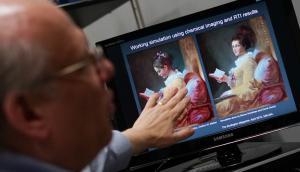 """Descubren nuevo rostro en la obra """"La Liseuse"""". Foto: AFP"""