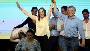 Vidal y Macri celebran la gran victoria. Foto: Reuters