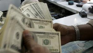 El billete verde está en $ 28,40 y el consenso es que suba para terminar el año a $ 30,20. Foto: AFP