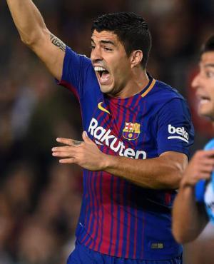 Suárez ante el Málaga. Foto: AFP.