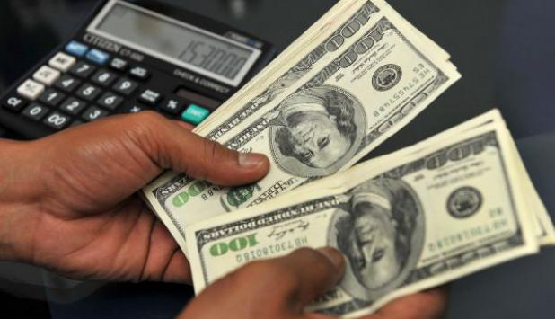 Ayer el dólar interbancario cotizó a $ 22,43 y en pizarras a $ 22,80. Foto: AFP