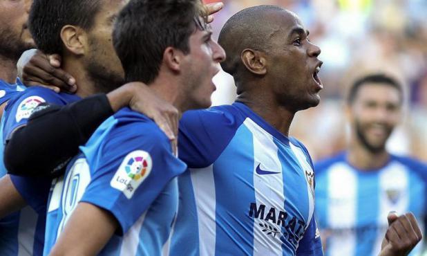 El grito de Diego Rolan en su primer tanto en Málaga. Foto: EFE