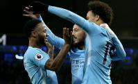 Raheem Sterling, Leroy Sane y David Silva, tres responsables de la gran campaña del Manchester City. Foto: EFE