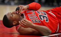 Kris Dunn tras la caída. Foto: AFP